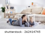 mom and daughter in the living... | Shutterstock . vector #262414745