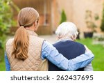young carer walking with the... | Shutterstock . vector #262437695