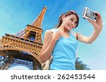 Stock photo happy travel woman in paris with eiffel tower and she take a selfie picture asian beauty 262453544