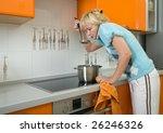 young woman preparing food in... | Shutterstock . vector #26246326