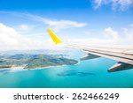 wing of an airplane flying... | Shutterstock . vector #262466249