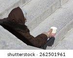 A Homeless Female Beggar Is...