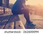 athlete resting on bench in... | Shutterstock . vector #262600094