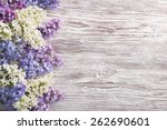 Lilac Flowers Bouquet On Woode...