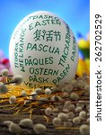 Easter egg on old farmhouse  rustic wooden table on blue window background - stock photo