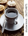 Small photo of �¡ake and cup of coffee on the wooden table