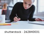 young woman working at her desk ... | Shutterstock . vector #262840031