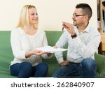 happy couple sitting at table... | Shutterstock . vector #262840907
