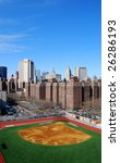 View over a baseball field to downtown of Manhattan in New York - stock photo
