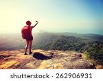 woman hiker taking photo with... | Shutterstock . vector #262906931