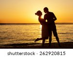 Romantic Couple On The Beach A...