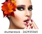 Trendy autumnal makeup and nail art. Fashion beauty model girl. Professional fall fashion makeup and manicure. Closeup portrait isolated on white with copy space - stock photo