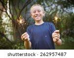 smiling boy holding sparklers.  ...   Shutterstock . vector #262957487