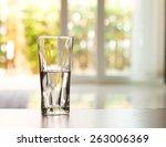 Closeup Glass Of Water On Tabl...