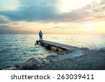 solitary man stand on boardwalk ... | Shutterstock . vector #263039411