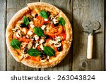 tasty pizza on a wooden board .  | Shutterstock . vector #263043824