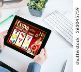 online gambler gambling at the... | Shutterstock . vector #263045759