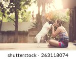 women hugging a dog and kiss.... | Shutterstock . vector #263118074