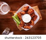 bbq buffalo chicken wings with... | Shutterstock . vector #263123705