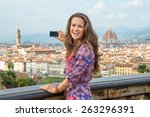 happy young woman taking photo... | Shutterstock . vector #263296391