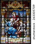 Small photo of Porto, Portugal - March 23, 2015: Stained glass window from church of Lapa representing a scene of the holy family, seeing Jesus learning carpentry, the office of the adoptive father, St. Joseph