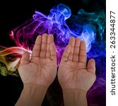 praying hands over misty smoke  | Shutterstock . vector #263344877