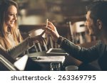 young fashionable couple at the ... | Shutterstock . vector #263369795