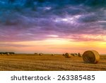 Sunset Over Farm Field With Ha...