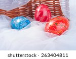 Small photo of Decorative Easter Eggs on the Snow like Surface near Raddle