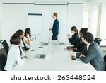 young business people sitting... | Shutterstock . vector #263448524