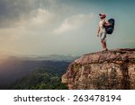 young hiker with backpack... | Shutterstock . vector #263478194