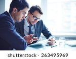 serious businessman explaining... | Shutterstock . vector #263495969