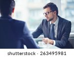 serious businessman working... | Shutterstock . vector #263495981