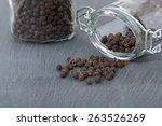 Black Peppercorns Spilled From...