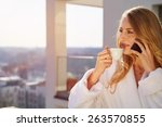 drinking coffee at home....   Shutterstock . vector #263570855