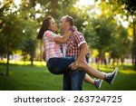 young couple playing in the park | Shutterstock . vector #263724725
