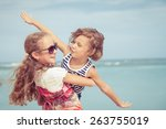 sister and brother playing on... | Shutterstock . vector #263755019