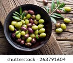 Wooden Bowl Full Of Olives And...