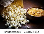 A Bowl Of Popcorn And Kernels...