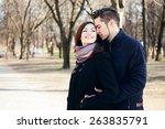young happy couple hugging in...   Shutterstock . vector #263835791