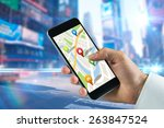 Man Using Map App On Phone...