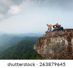 hiker relaxing on top of the... | Shutterstock . vector #263879645