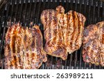 beef steaks being prepared on... | Shutterstock . vector #263989211