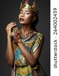 black girl with jewels on a... | Shutterstock . vector #264002459