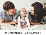 happy young father  mother and... | Shutterstock . vector #264029867