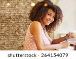 a young woman writing on a... | Shutterstock . vector #264154079