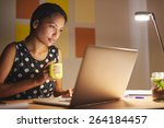 a young woman working on her... | Shutterstock . vector #264184457