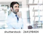 young businessman in office... | Shutterstock . vector #264198404