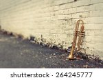 Old Worn Trumpet Stands Alone...