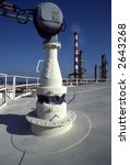 Picture of a refinery from the top of a storage tank. - stock photo